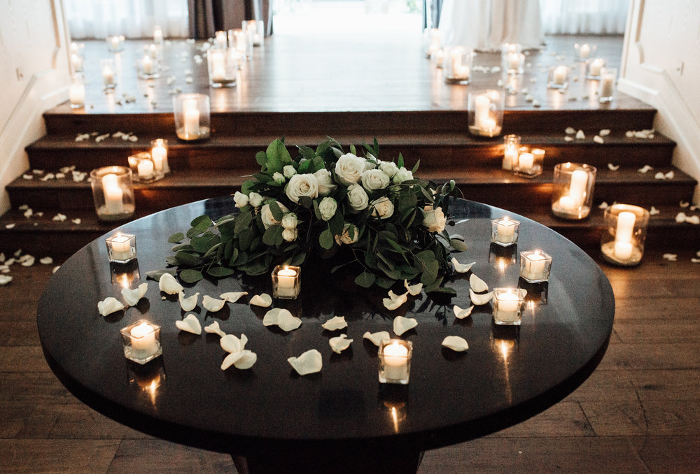 Rose petals and candles romantic rooftop marriage proposal | Wedding Proposal Planners Hotel Monaco Pittsburgh | Exhale Events