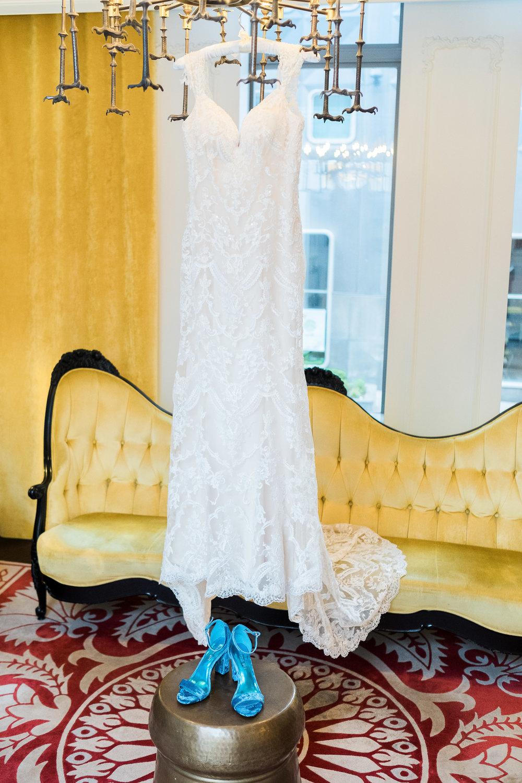 Bride's dress hanging in Hotel Monaco