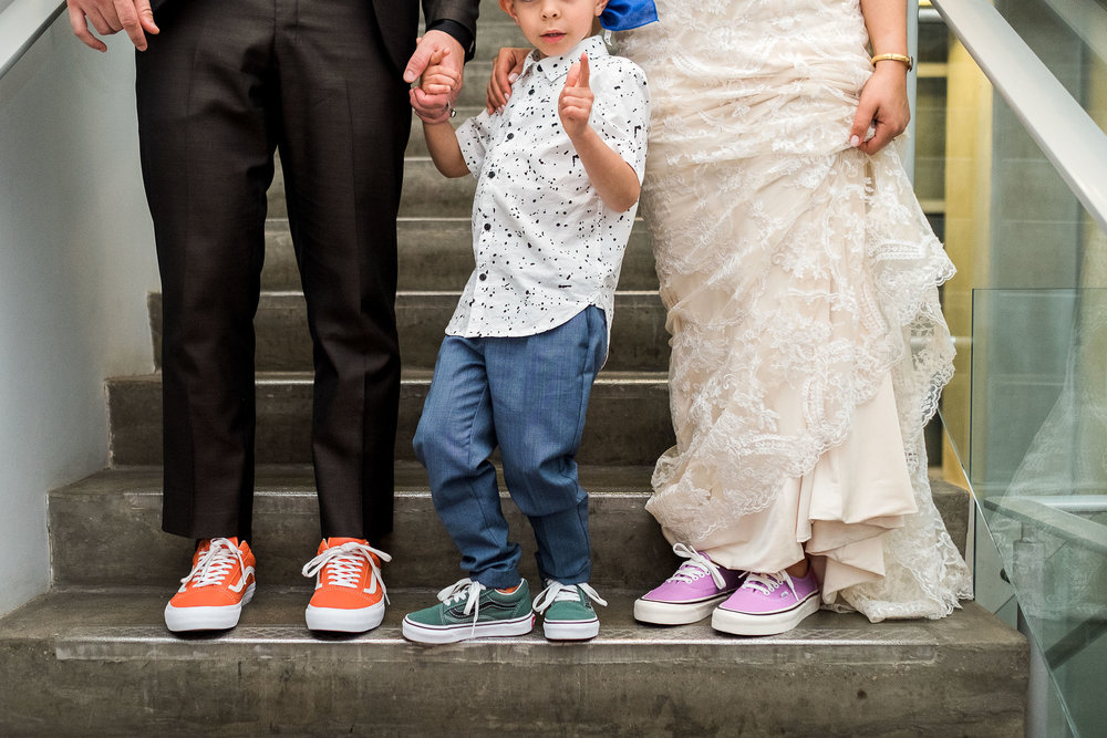 Bride and groom with vans