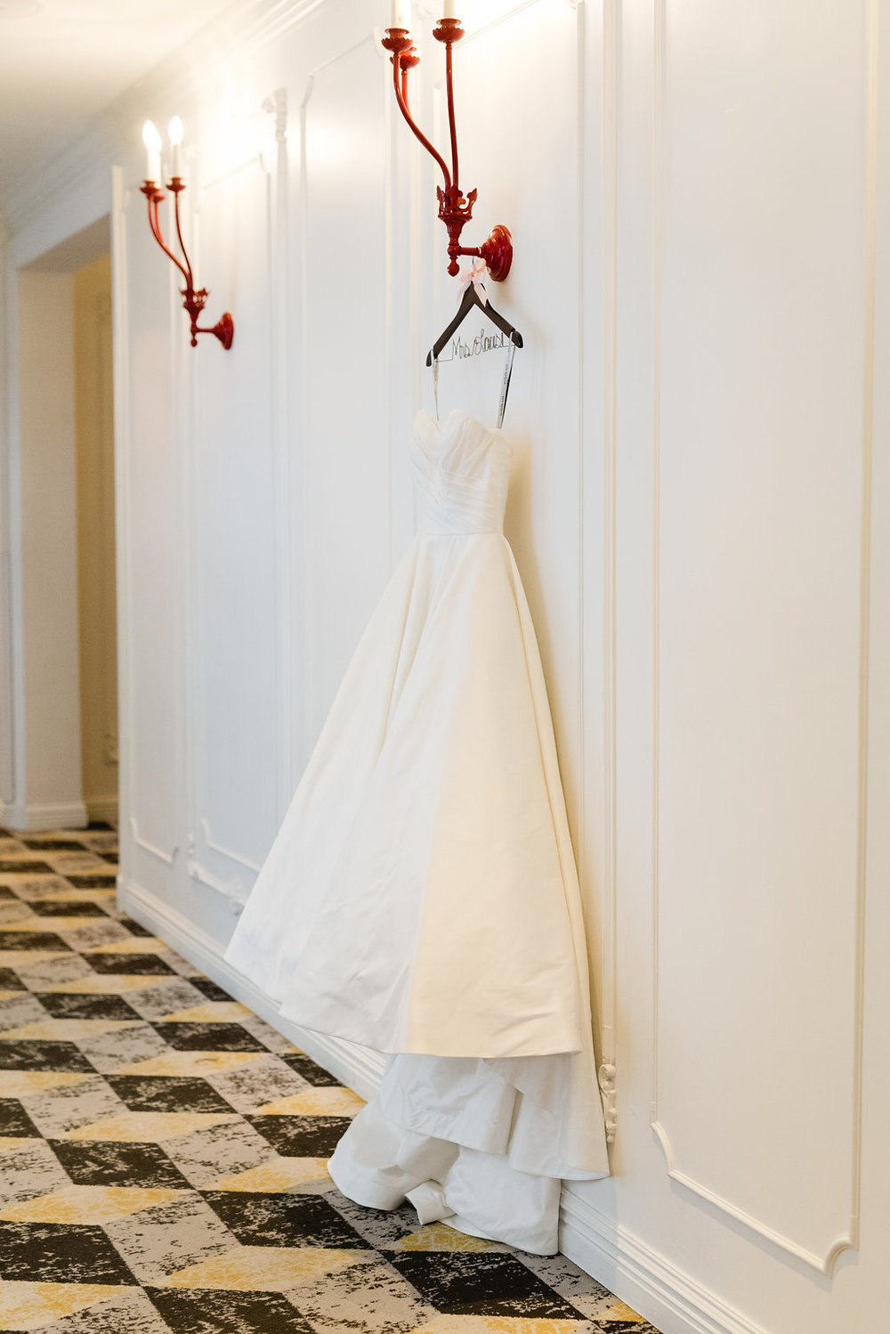 Wedding dress on name hanger for Pittsburgh wedding at Hotel Monaco