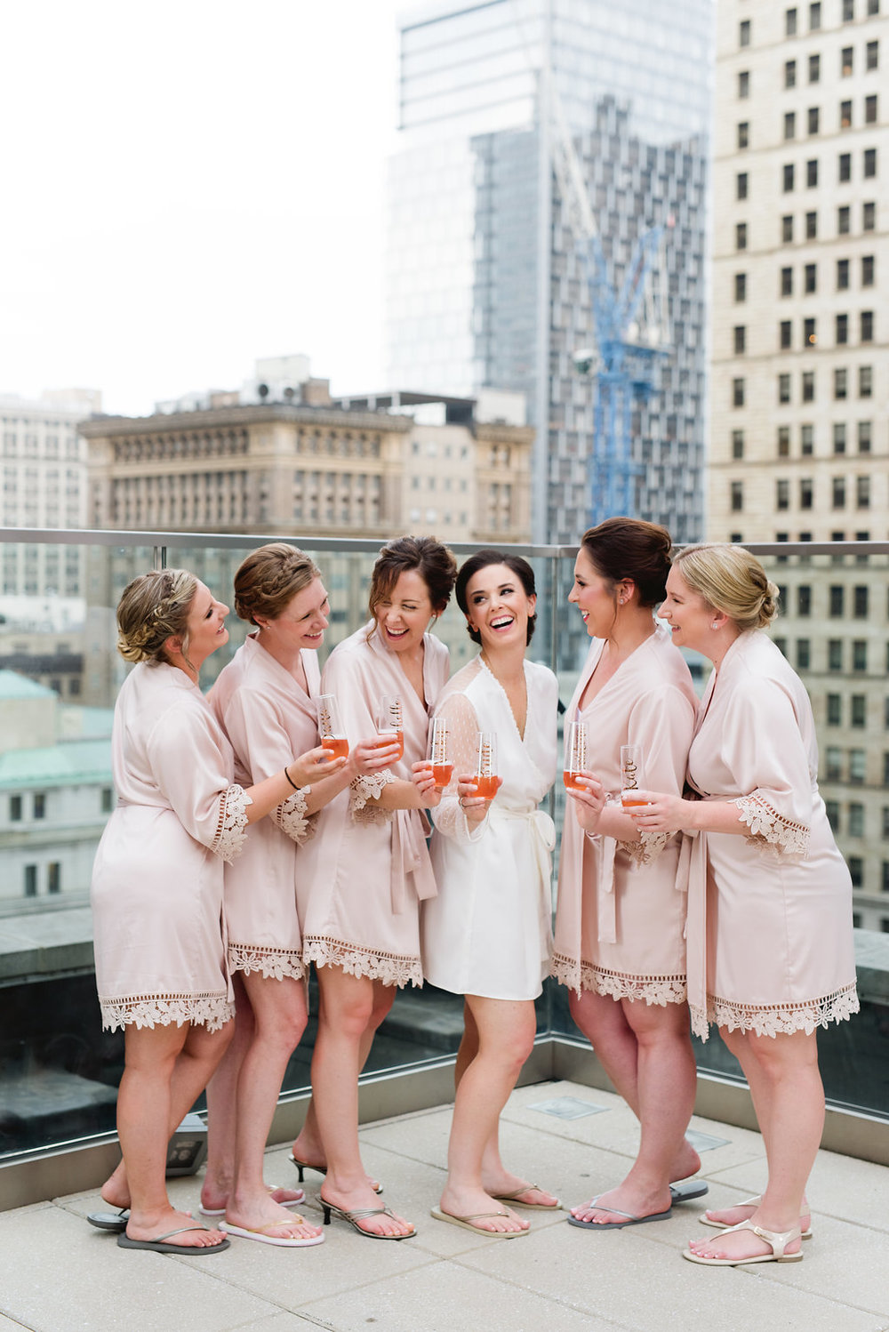 Bride with bridesmaid for champagne toast for Pittsburgh wedding at Hotel Monaco