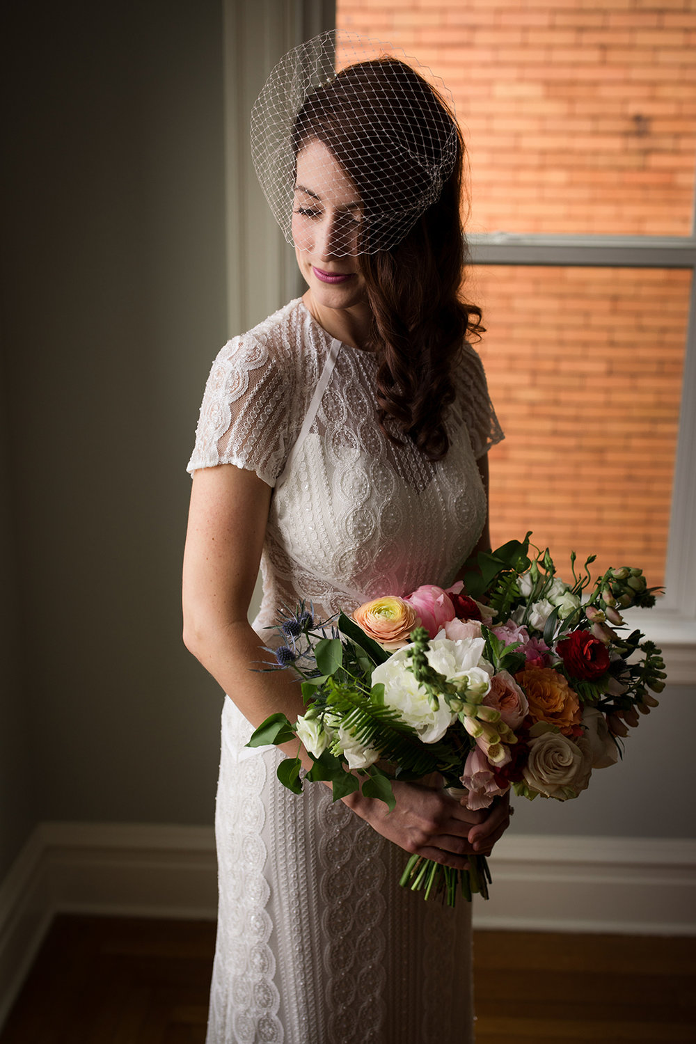 Bride in vintage style wedding gown and birdcage veil holding her wedding bouquet for Pittsburgh wedding at Ace Hotel. See more details at exhale-events.com!