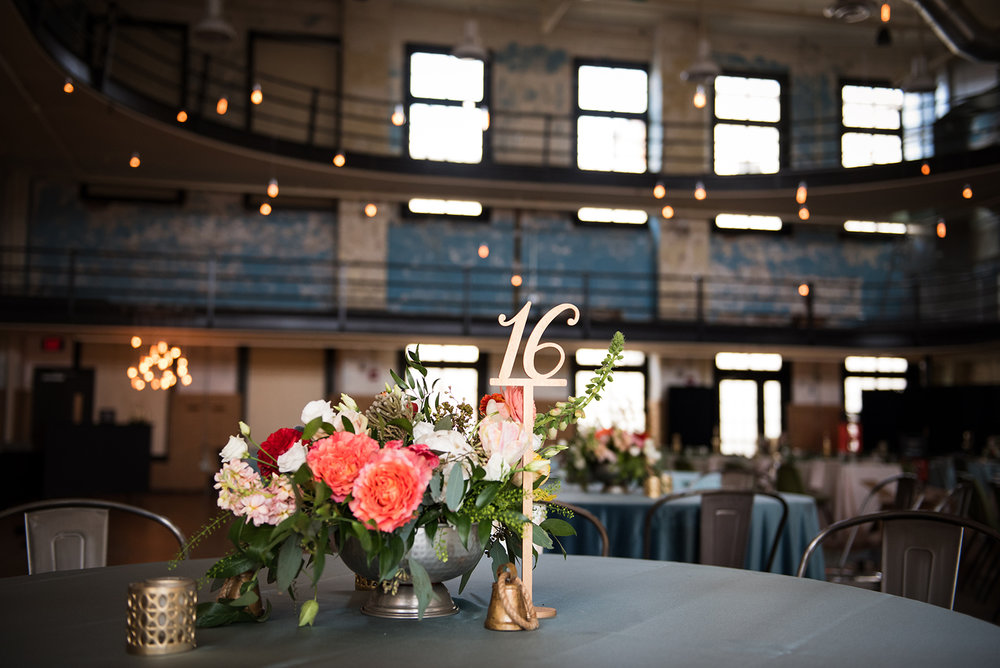Low wedding centerpieces and vintage wedding decor for school-themed vintage wedding in Pittsburgh at Ace Hotel. See more fun details at exhale-events.com!