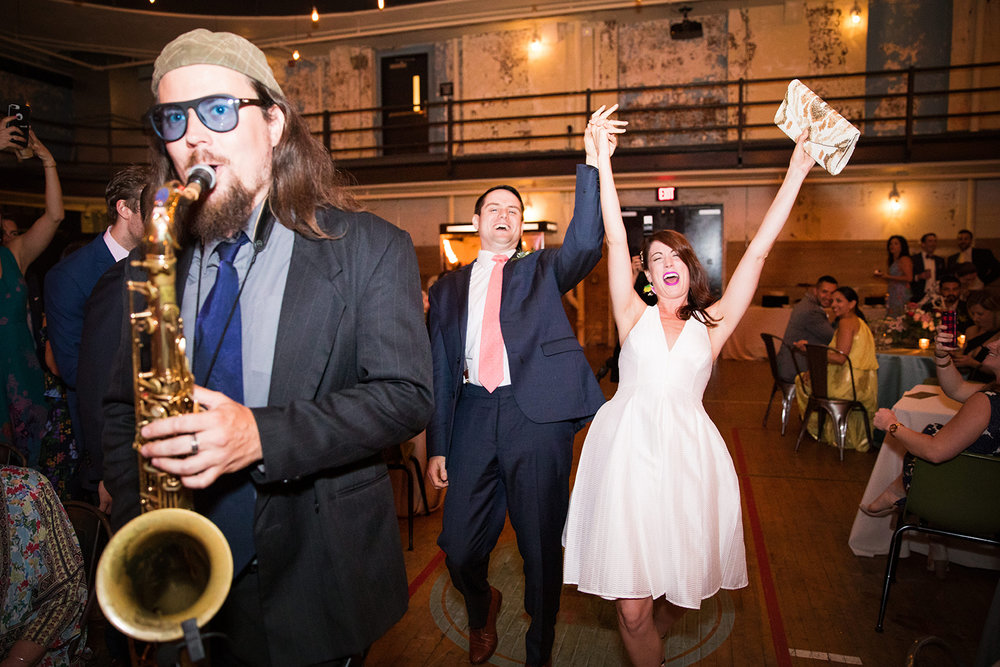 Bride in her second wedding dress dancing with groom at their school-themed vintage wedding reception at Ace Hotel in Pittsburgh. See more fun details at exhale-events.com