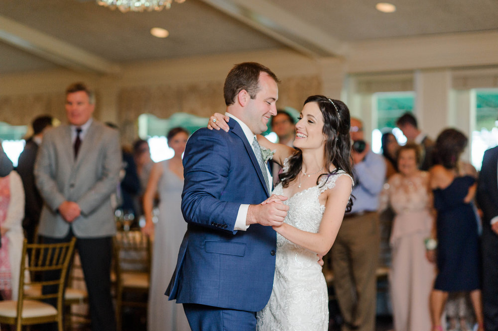 Bride and groom share first dance for elegant Greek wedding held in Pittsburgh at Oakmont Country Club. See more beautiful details at exhale-events.com!