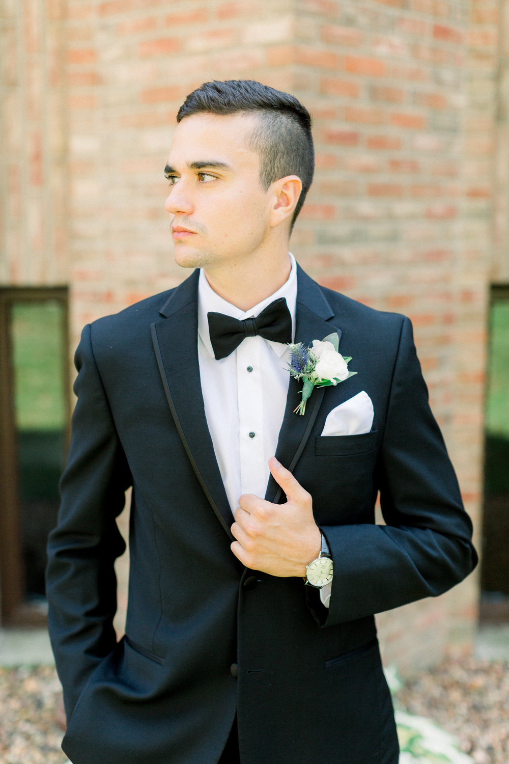 Groom in classic black tuxedo and bowtie getting ready for Pittsburgh wedding planned by Exhale Events. Find more wedding inspiration at exhale-events.com!