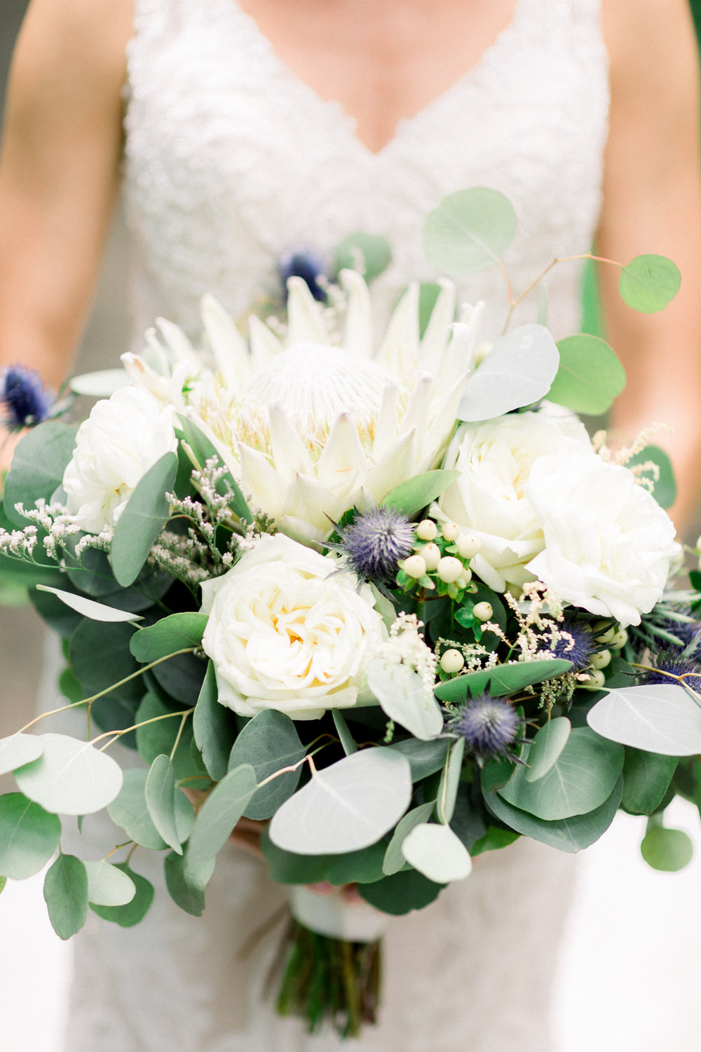 King protea wedding bouquet with greenery for Pittsburgh wedding planned by Exhale Events. Find more wedding inspiration at exhale-events.com!