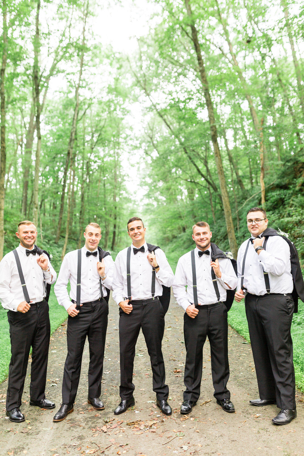 Groom and groomsmen take wedding photos in classic black tuxedos for Pittsburgh wedding planned by Exhale Events. Find more wedding inspiration at exhale-events.com!