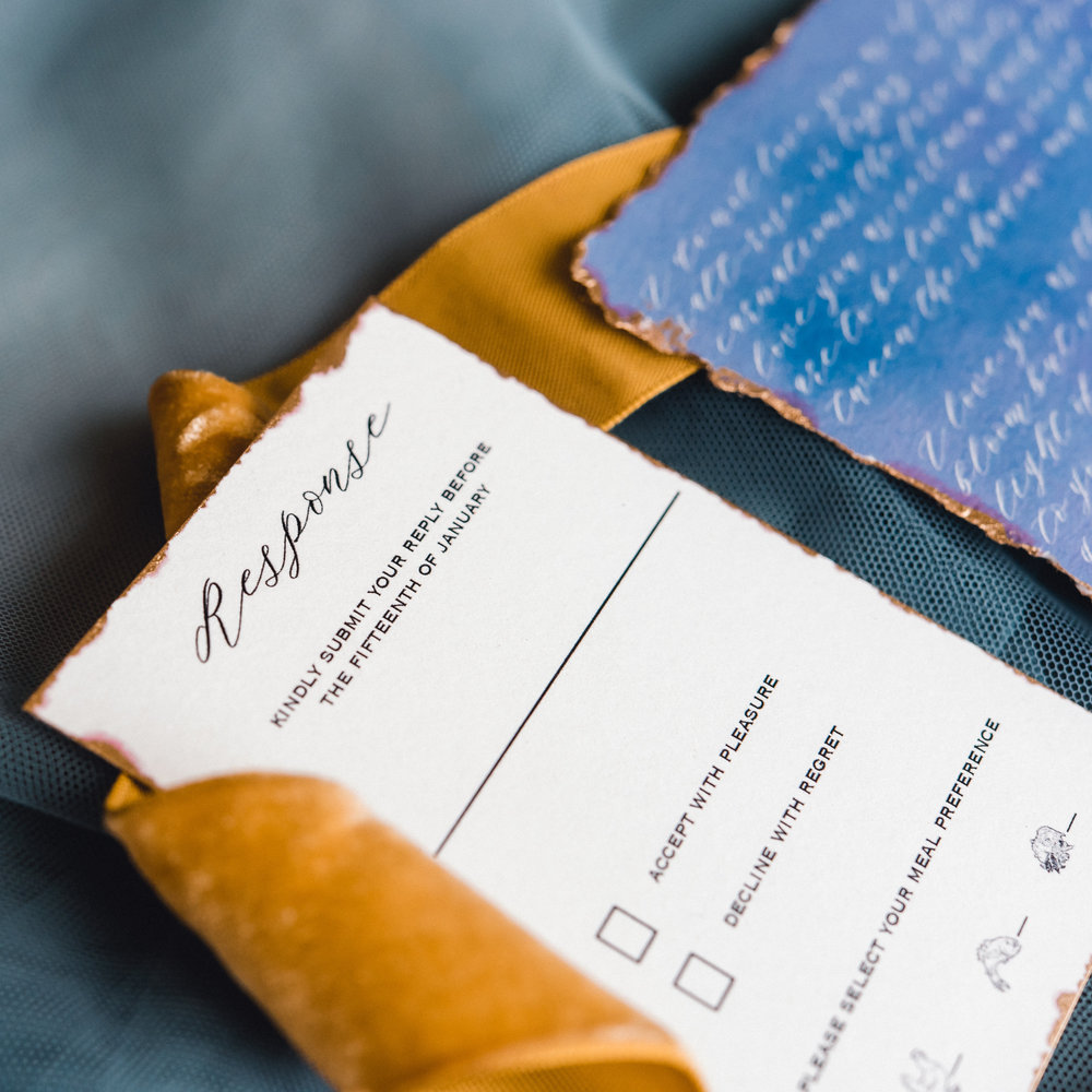 Blue wedding invitations with gold leafing for Pablo Neruda enchanting garden styled shoot planned by Exhale Events. Get inspired at exhale-events.com!