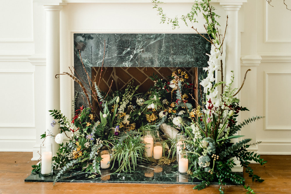 Fireplace designed with flowers at wedding venue for Pablo Neruda enchanting garden styled shoot planned by Exhale Events. Get inspired at exhale-events.com!