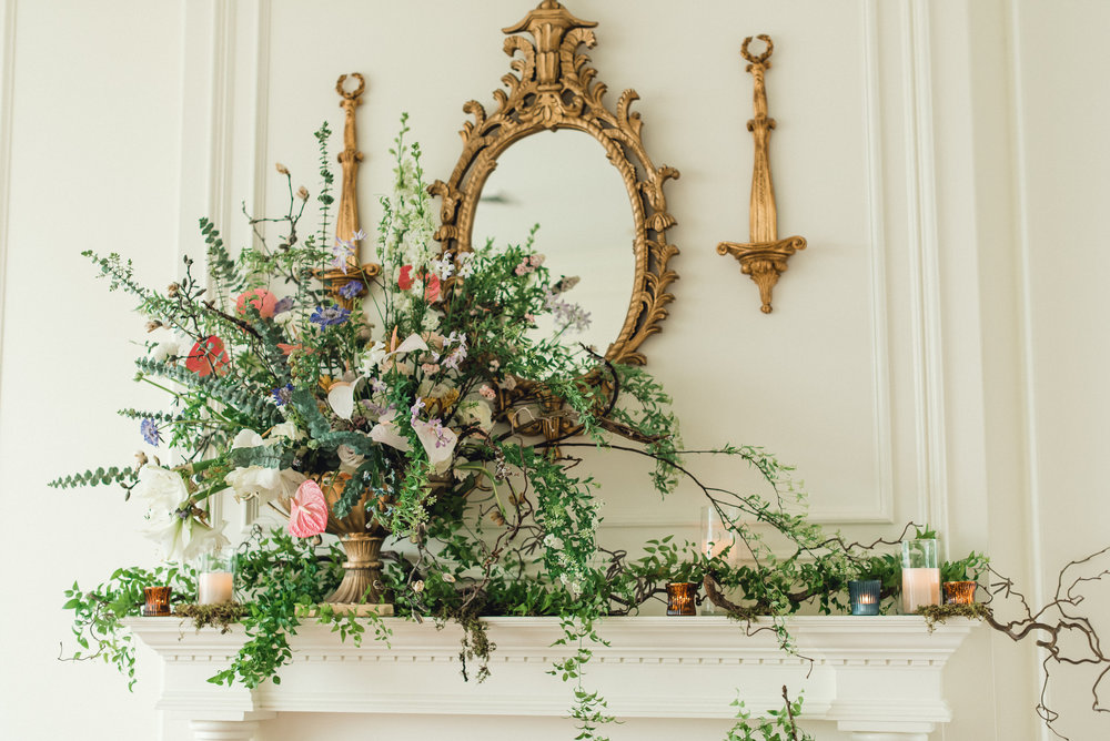 Mantel exploding with flowers at wedding venue for Pablo Neruda enchanting garden styled shoot planned by Exhale Events. Get inspired at exhale-events.com!