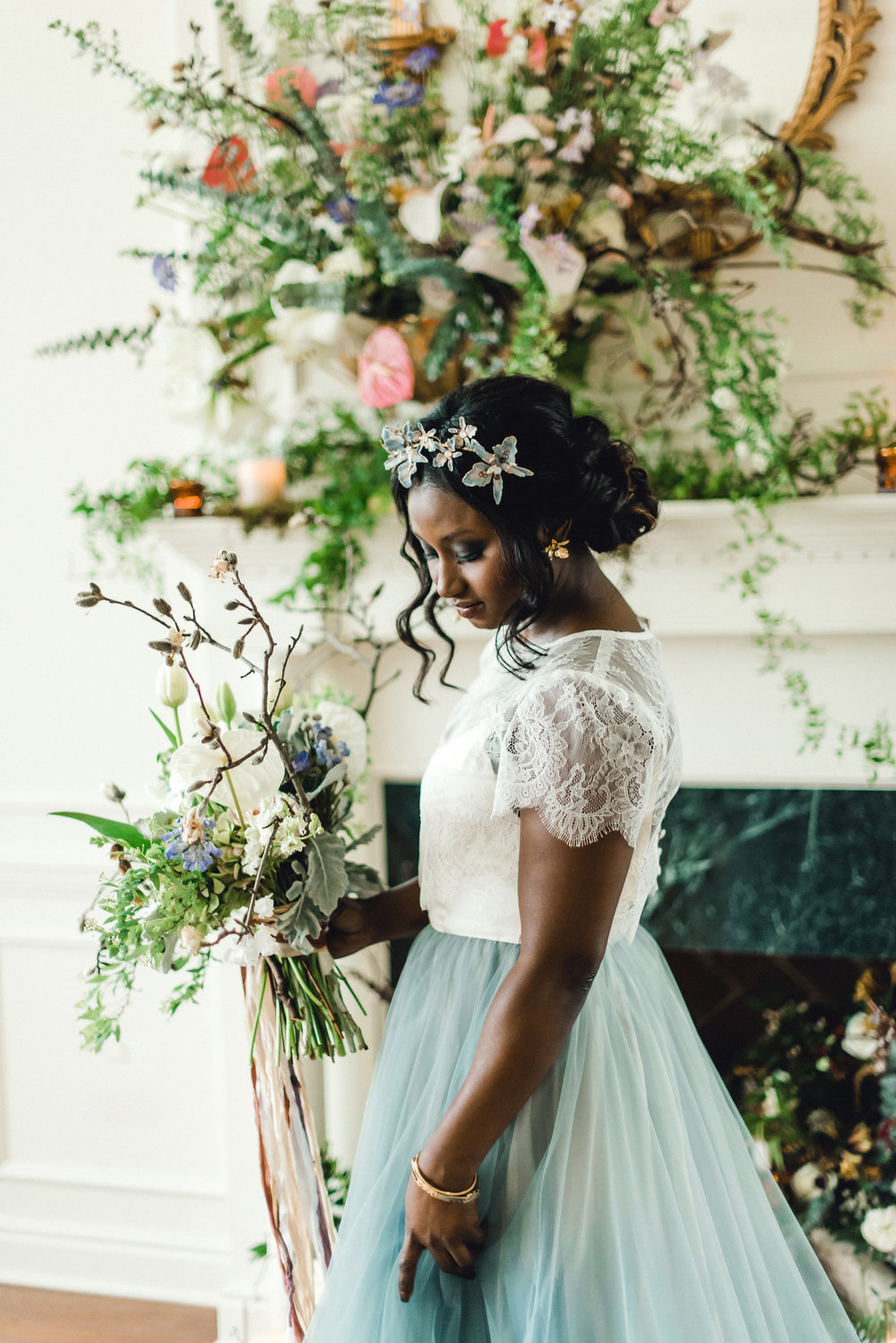 Bride poses in front of wedding decor at wedding venue for Pablo Neruda enchanting garden styled shoot planned by Exhale Events. Get inspired at exhale-events.com!