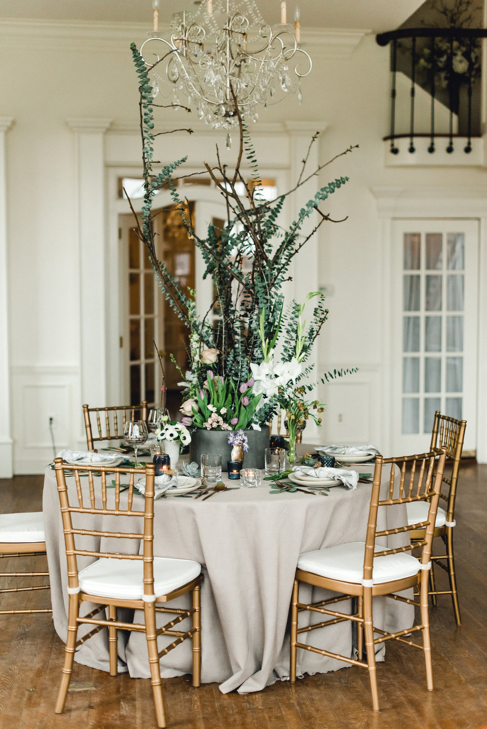 Tall, organic, unstructured wedding centerpieces for Pablo Neruda enchanting garden styled shoot planned by Exhale Events. Get inspired at exhale-events.com!