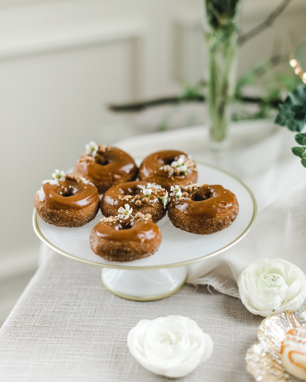 Charming wedding cake and dessert table with donuts for Pablo Neruda enchanting garden styled shoot planned by Exhale Events. Get inspired at exhale-events.com!