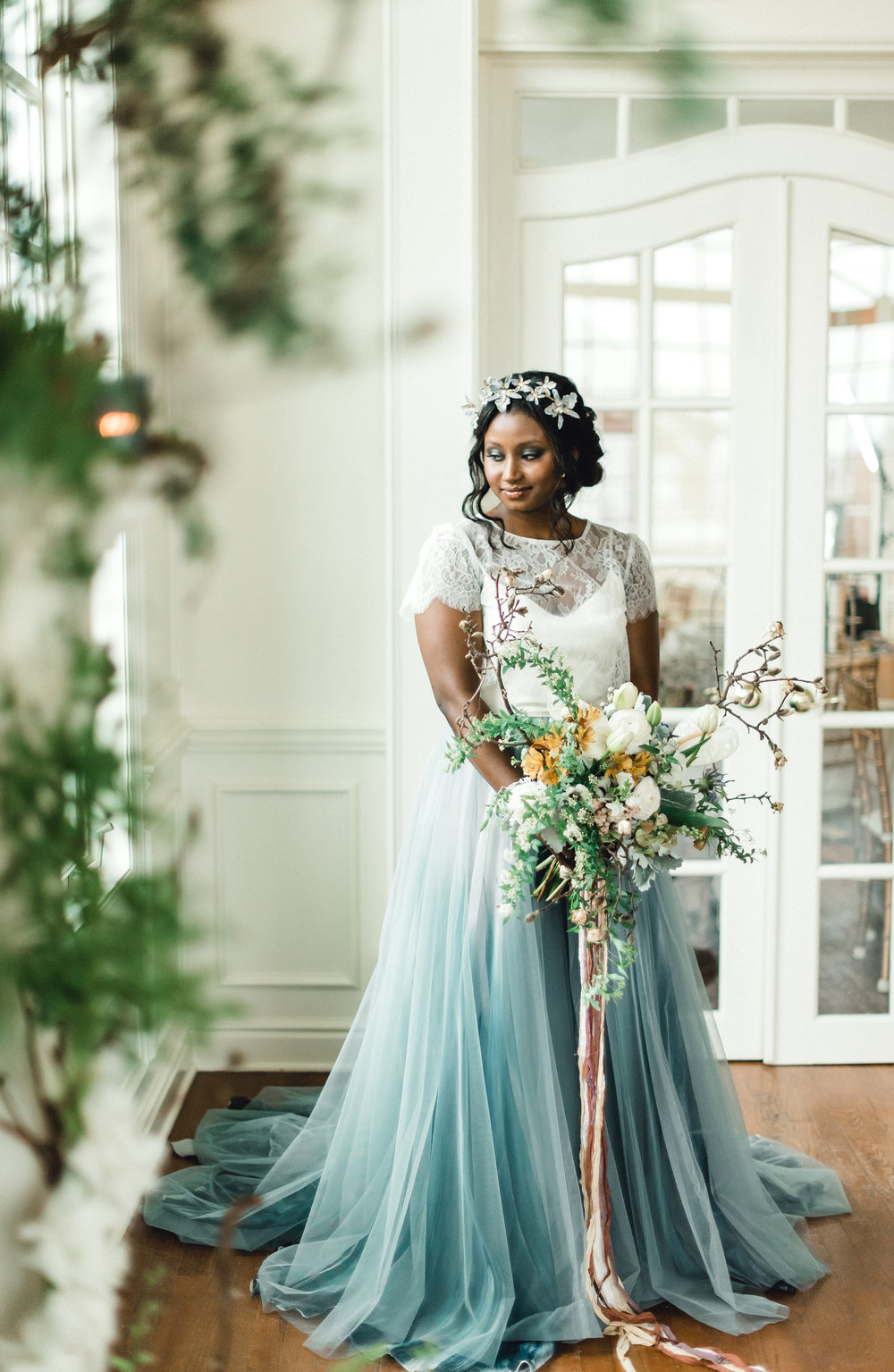 Bride poses with organic wedding bouquet at wedding venue for Pablo Neruda enchanting garden styled shoot planned by Exhale Events. Get inspired at exhale-events.com!