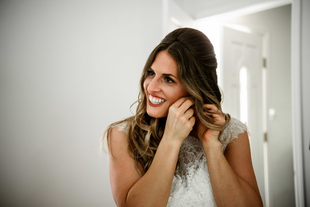 Bride getting ready for Pittsburgh wedding planned by Exhale Events. Find more inspiration at exhale-events.com!