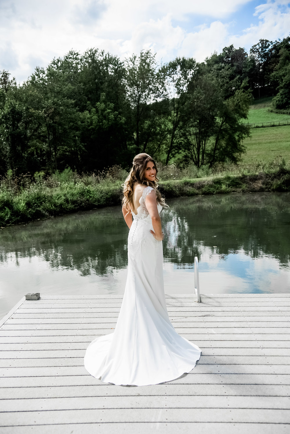 Bride poses for wedding photos in wedding dress for Pittsburgh wedding planned by Exhale Events. Find more inspiration at exhale-events.com!