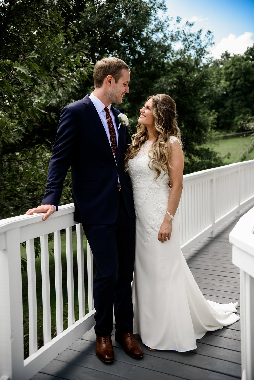 Bride and groom pose for outdoor wedding photos at Pittsburgh wedding planned by Exhale Events. Find more wedding inspiration at exhale-events.com!