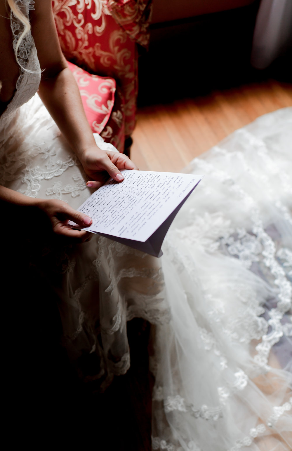 Bride reading letting from groom at Buffalo, NY wedding planned by Exhale Events. Find more wedding inspiration at exhale-events.com!