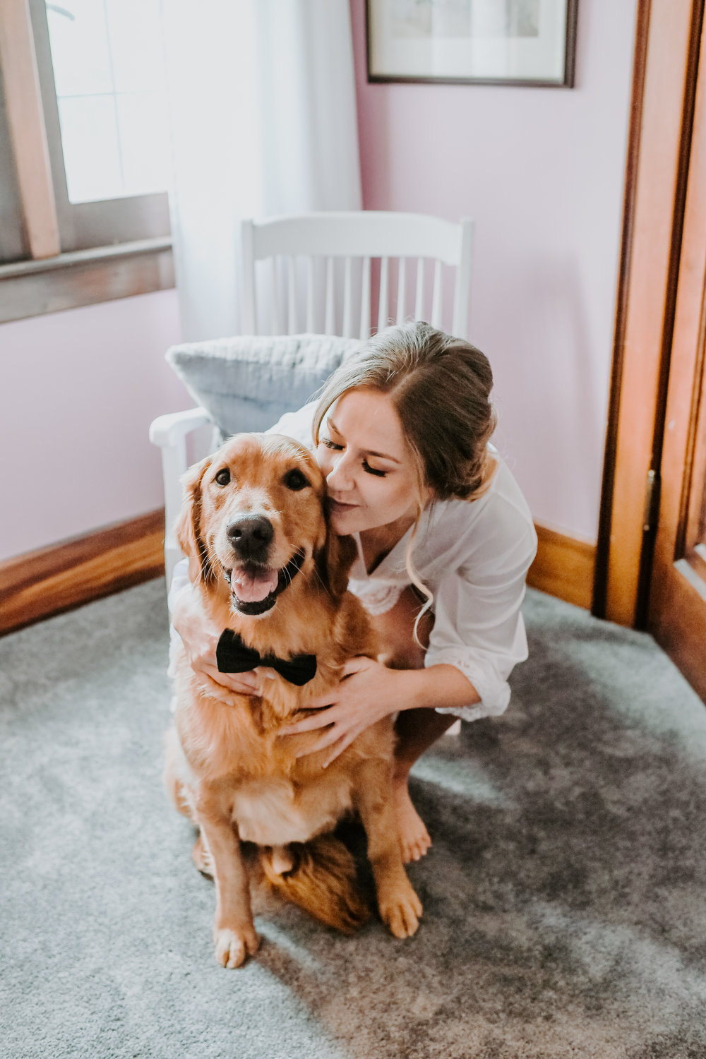 Dog at wedding with bride for Buffalo, NY wedding planned by Exhale Events. Find more wedding inspiration at exhale-events.com!