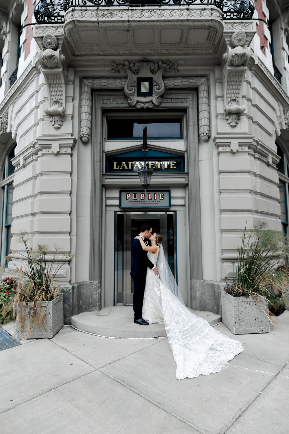 Bride and groom pose for wedding pictures outside at Buffalo, NY wedding planned by Exhale Events. Find more wedding inspiration at exhale-events.com!