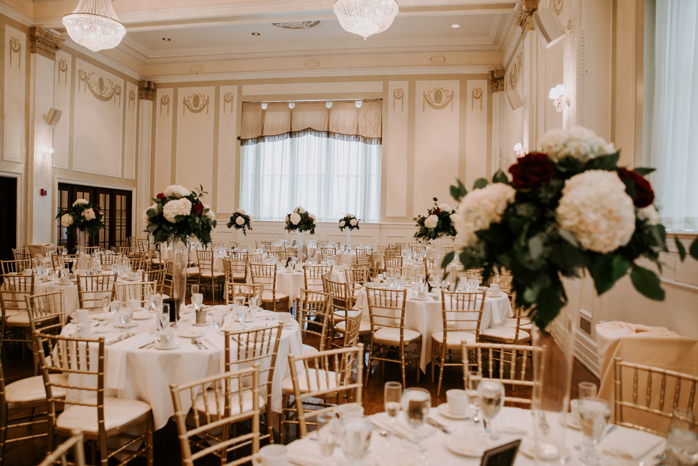 Wedding reception design with gold wedding accents for Buffalo, NY wedding planned by Exhale Events. Find more wedding inspiration at exhale-events.com!