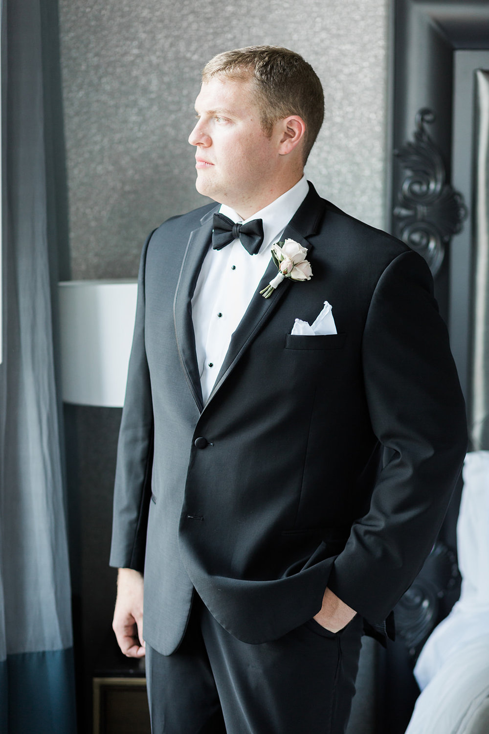 Groom poses for wedding photos for Pittsburgh wedding at PNC Park planned by Exhale Events. Find more wedding inspiration at exhale-events.com!