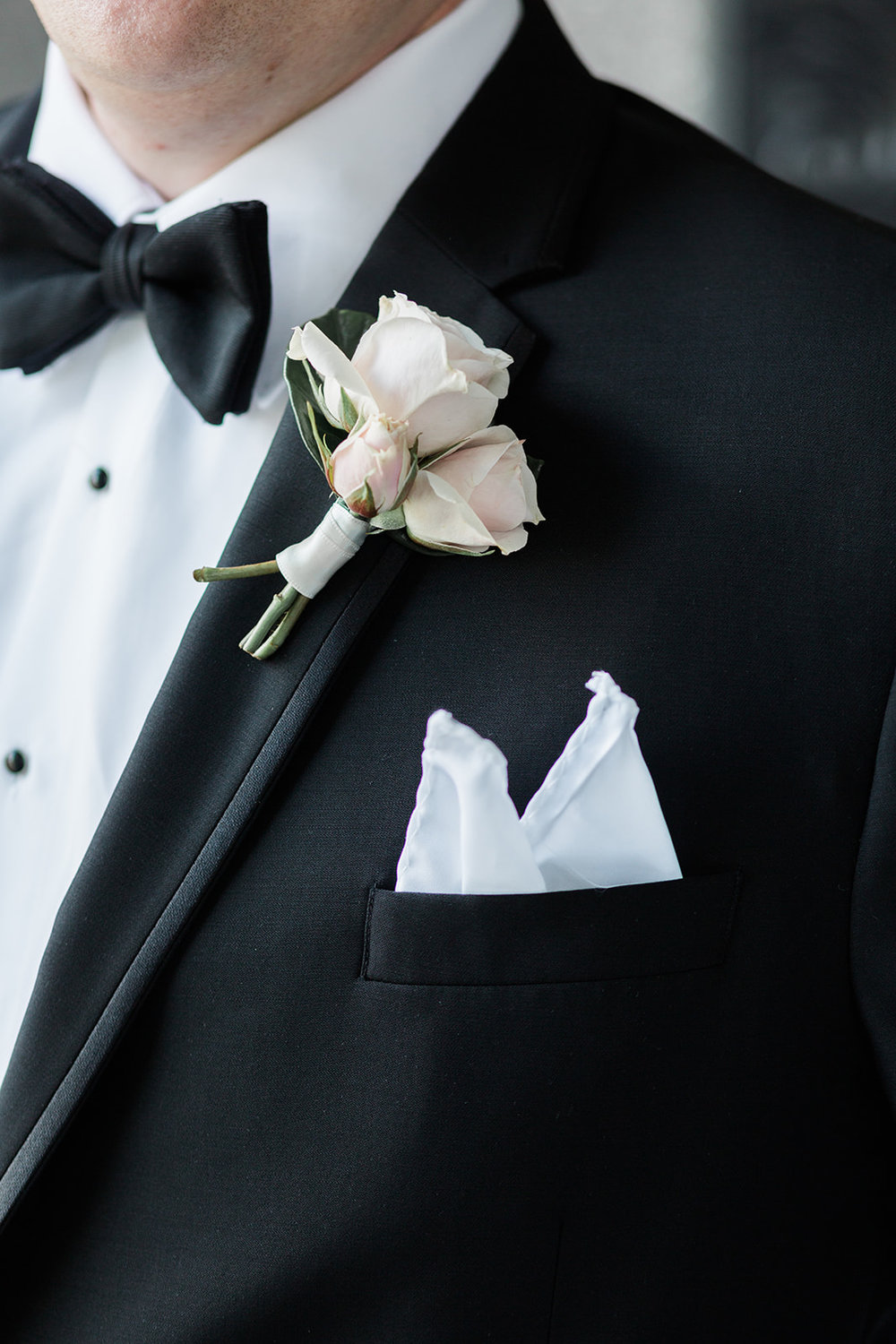 Groom's wedding style in black tuxedo and bow tie for Pittsburgh wedding at PNC Park planned by Exhale Events. Find more wedding inspiration at exhale-events.com!