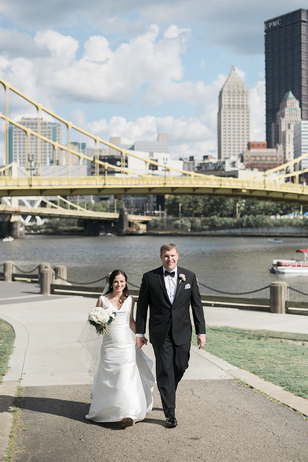 Bride and groom pose for wedding photos for Pittsburgh wedding at PNC Park planned by Exhale Events. Find more wedding inspiration at exhale-events.com!