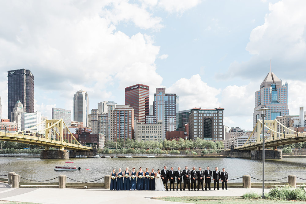 Wedding party poses for wedding photos for Pittsburgh wedding at PNC Park planned by Exhale Events. Find more wedding inspiration at exhale-events.com!