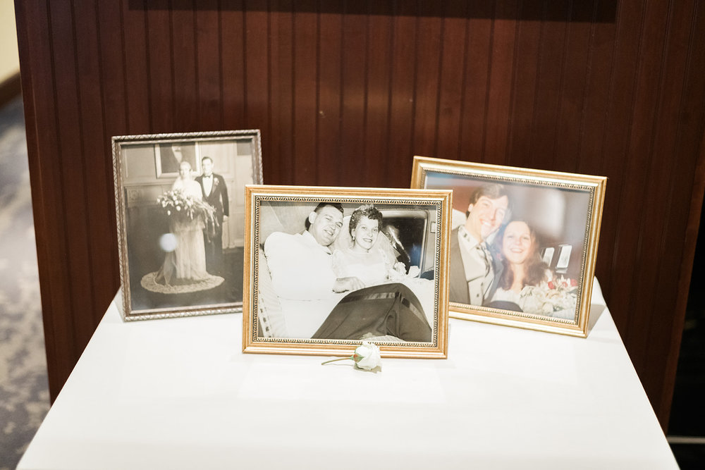 Family photographs displayed at wedding reception for Pittsburgh wedding at PNC Park planned by Exhale Events. Find more wedding inspiration at exhale-events.com!