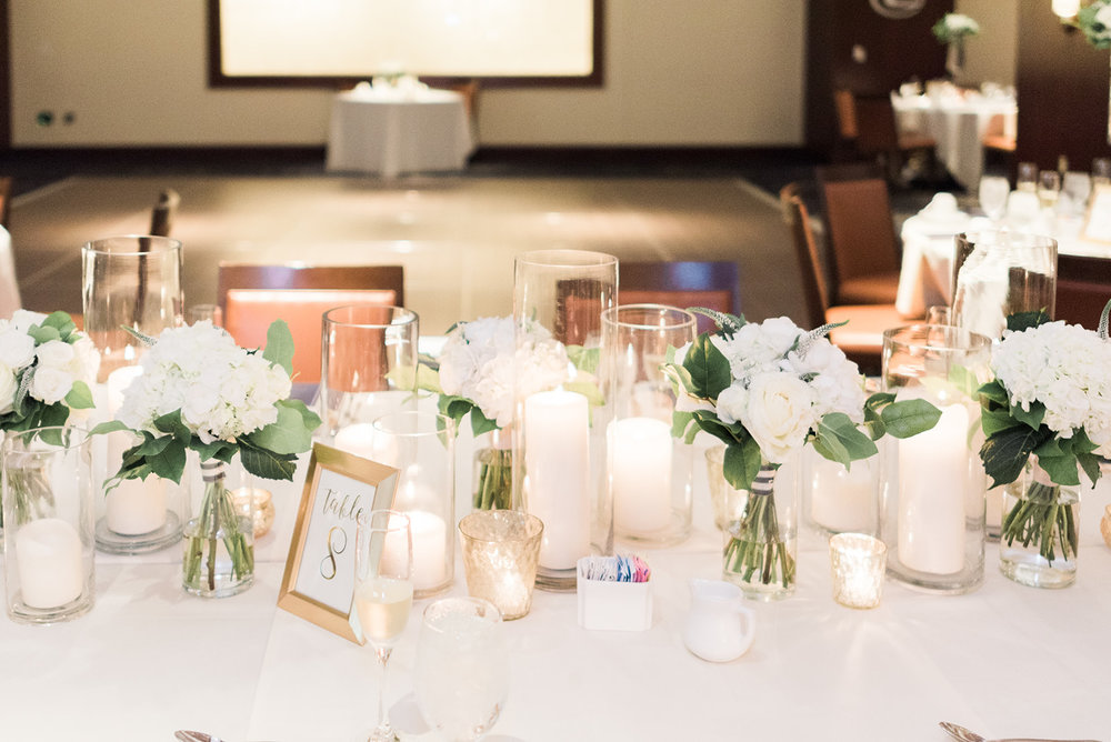 Wedding table decor for wedding reception with white floral centerpieces  and candles for Pittsburgh wedding at PNC Park planned by Exhale Events. Find more wedding inspiration at exhale-events.com!