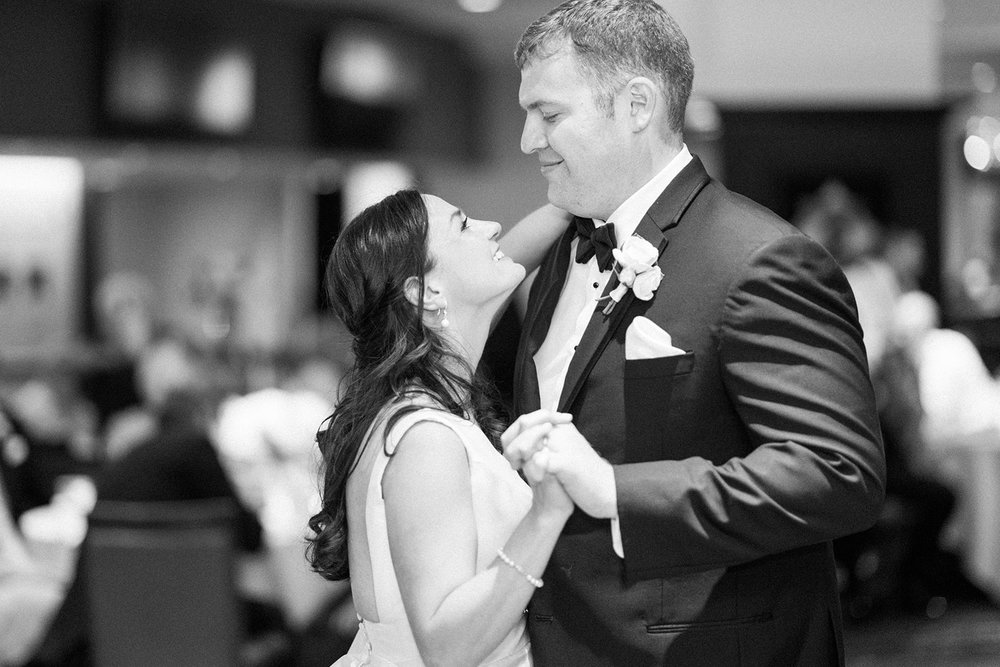 Bride and groom share their first dance at Pittsburgh wedding at PNC Park planned by Exhale Events. Find more wedding inspiration at exhale-events.com!