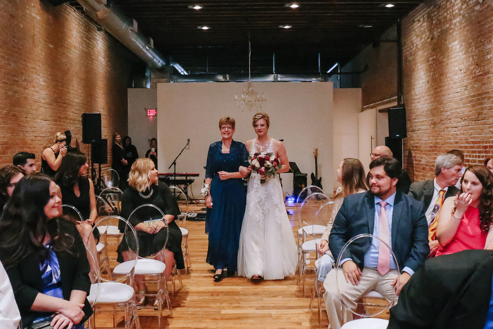 Bride walks down the aisle during wedding ceremony for Pittsburgh wedding at Studio Slate planned by Exhale Events. Find more wedding inspiration at exhale-events.com!