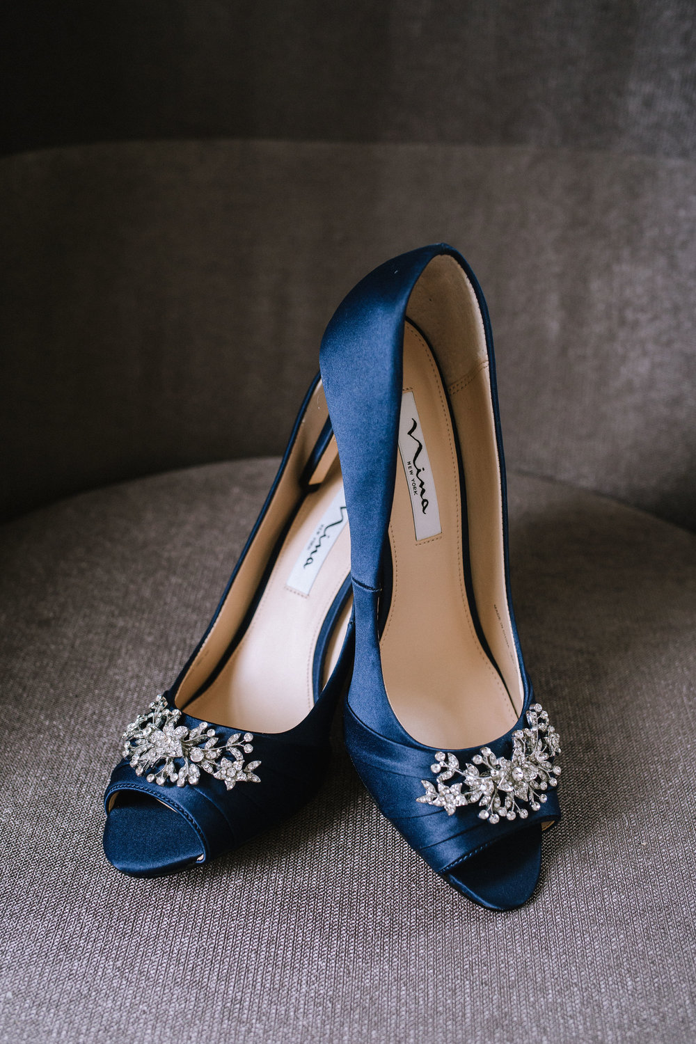 Bride's blue embellished Badgley Mischka wedding shoes for Pittsburgh wedding at Studio Slate planned by Exhale Events. Find more wedding inspiration at exhale-events.com!