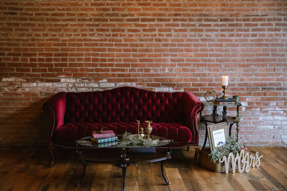 Red settee and vintage wedding decor for Pittsburgh wedding at Studio Slate planned by Exhale Events. Find more wedding inspiration at exhale-events.com!