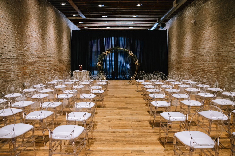 Modern wedding ceremony decor with moon arch for Pittsburgh wedding at Studio Slate planned by Exhale Events. Find more wedding inspiration at exhale-events.com!
