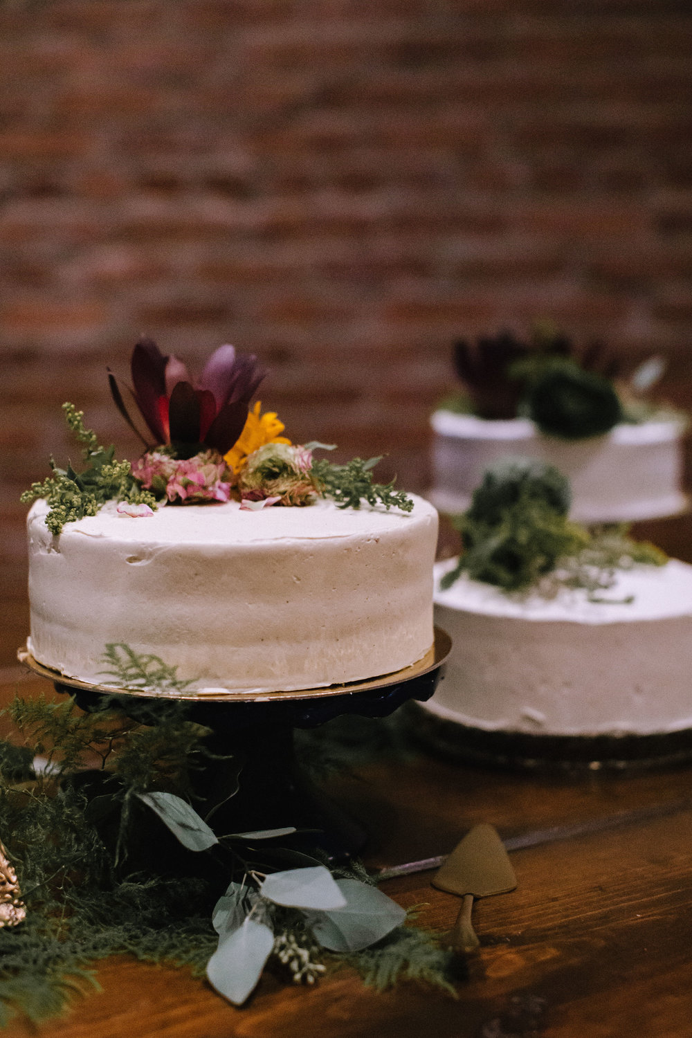 Multiple one tier wedding cakes for Pittsburgh wedding at Studio Slate planned by Exhale Events. Find more wedding inspiration at exhale-events.com!