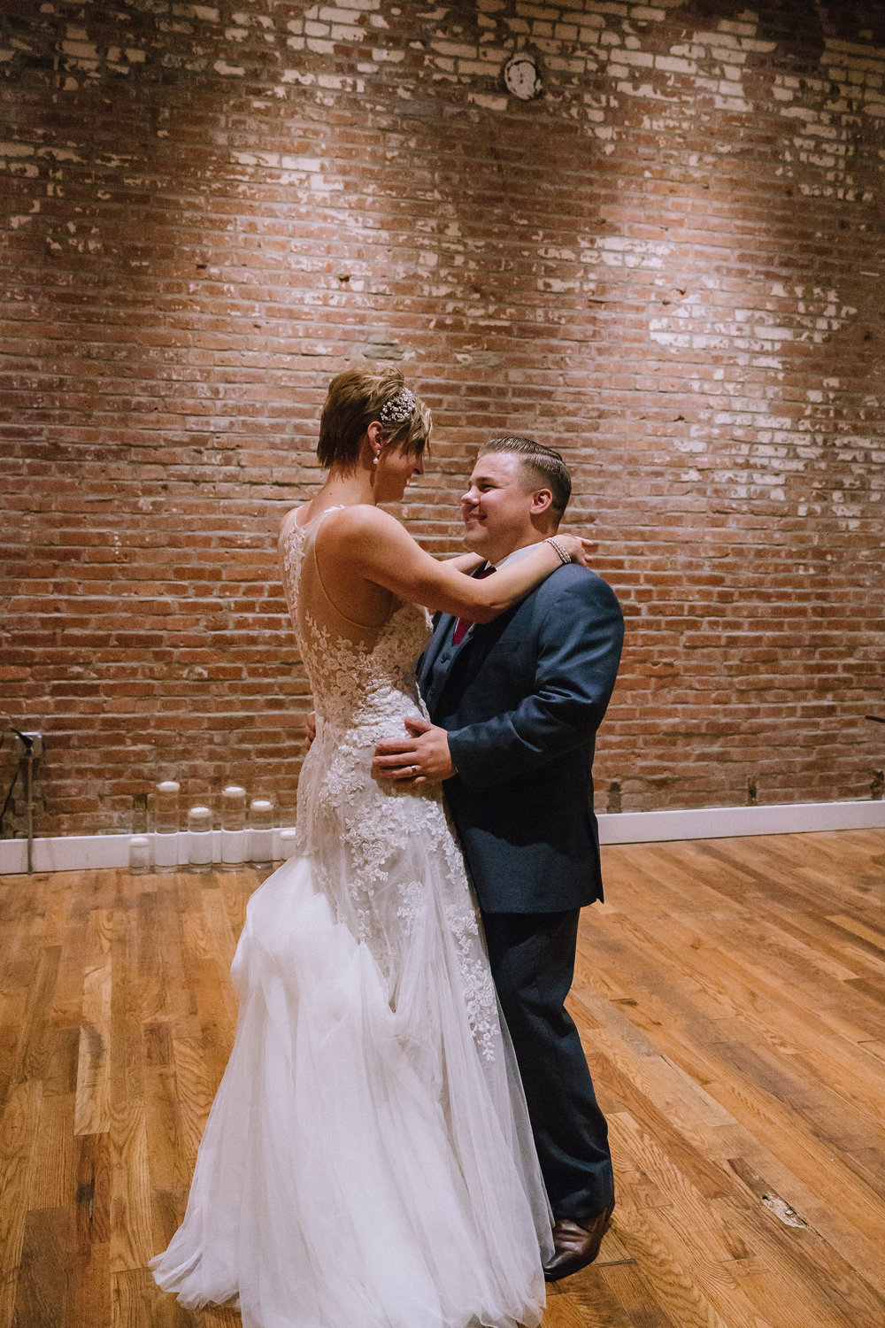 Bride and groom share first dance at Pittsburgh wedding at Studio Slate planned by Exhale Events. Find more wedding inspiration at exhale-events.com!