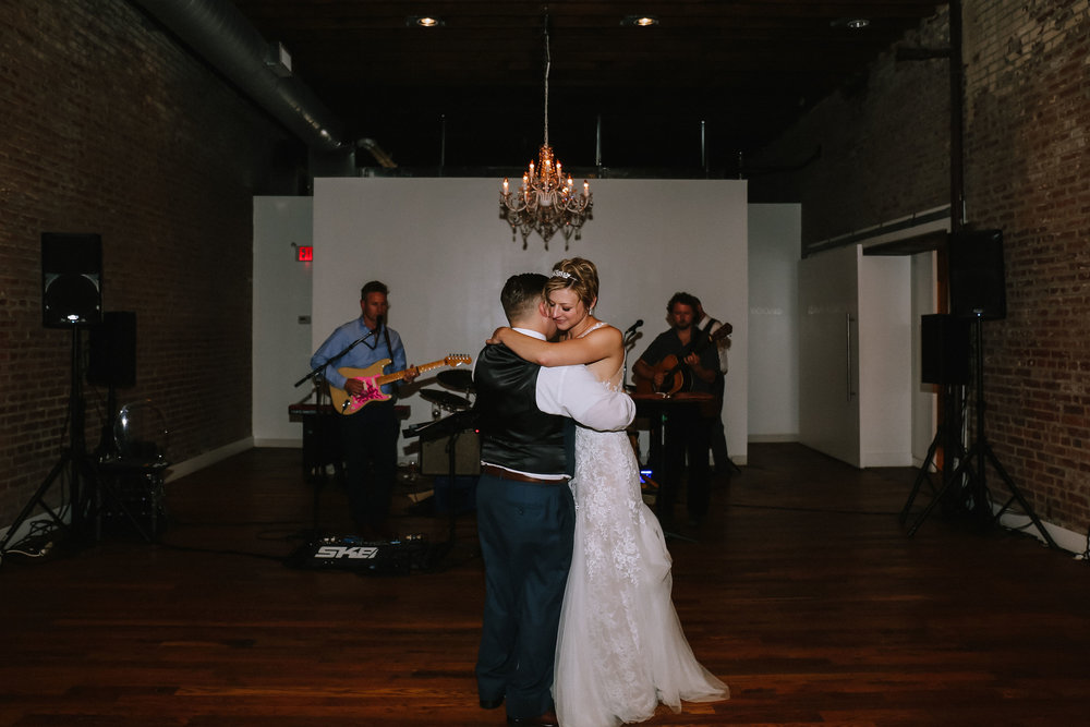 Bride and groom share a dance at Pittsburgh wedding at Studio Slate planned by Exhale Events. Find more wedding inspiration at exhale-events.com!