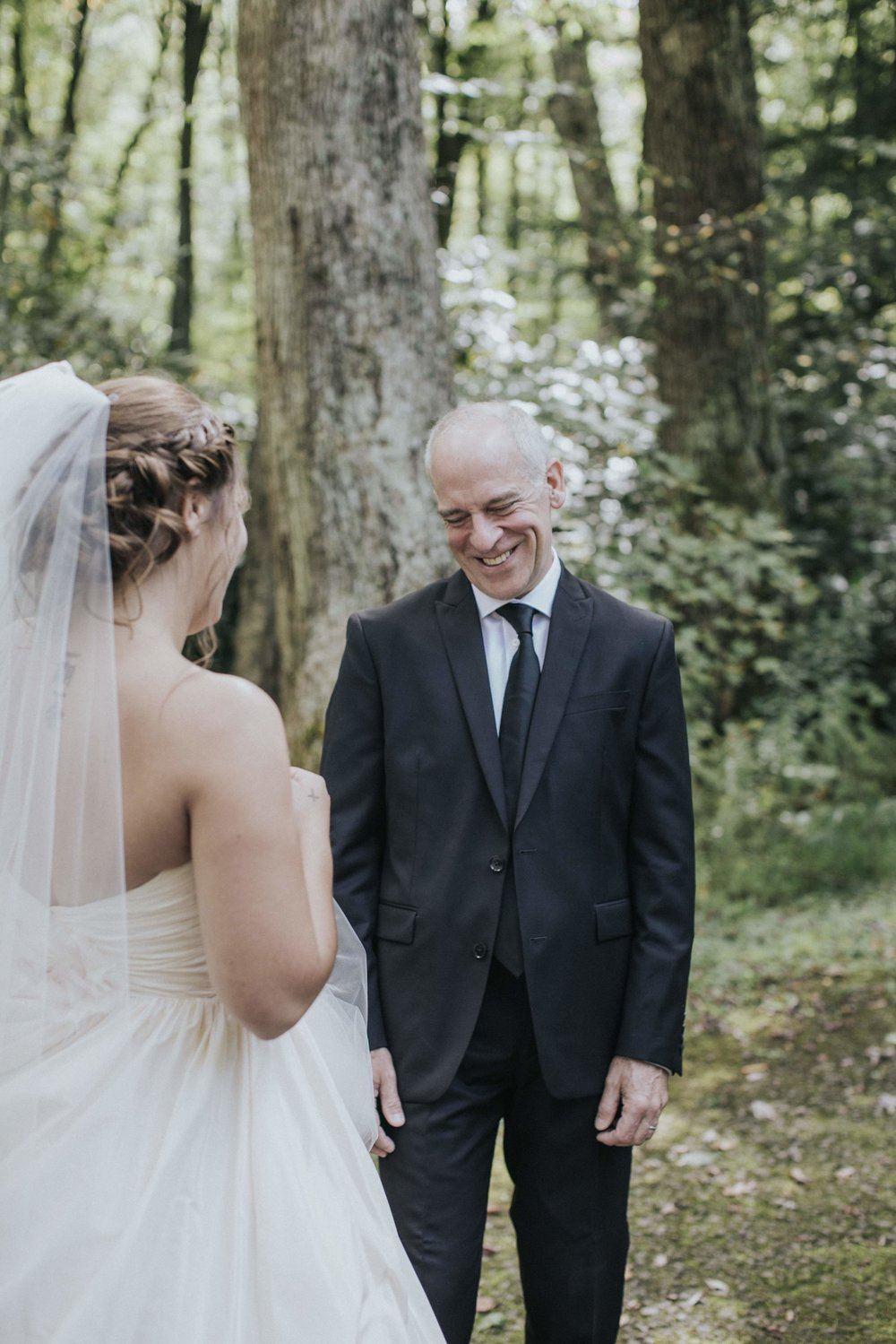 Bride shares a first look with her father for rustic wedding in Farmington, PA planned by Exhale Events. Find more wedding inspiration at exhale-events.com!