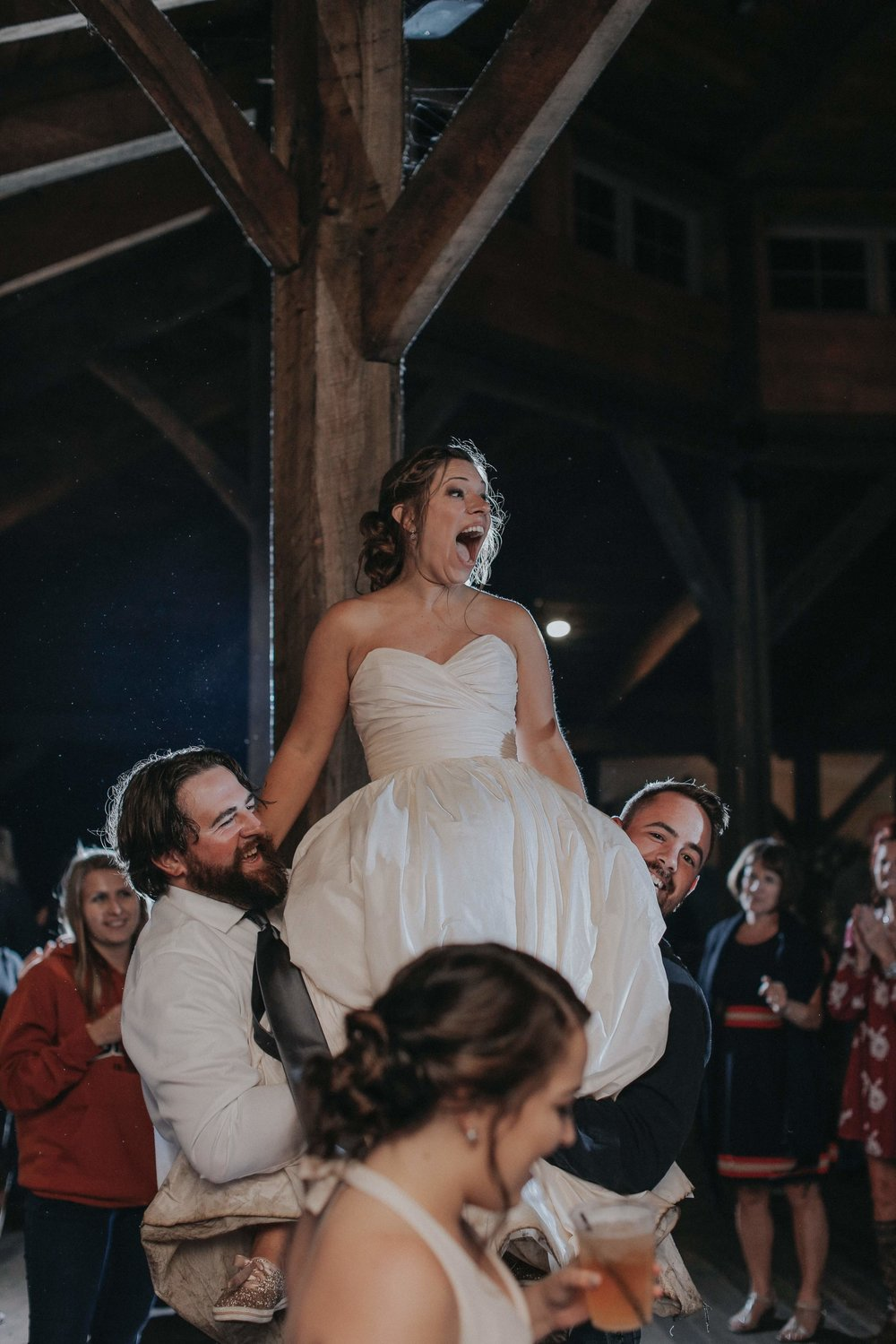 Bride celebrating at wedding reception at rustic wedding in Farmington, PA planned by Exhale Events. Find more wedding inspiration at exhale-events.com!