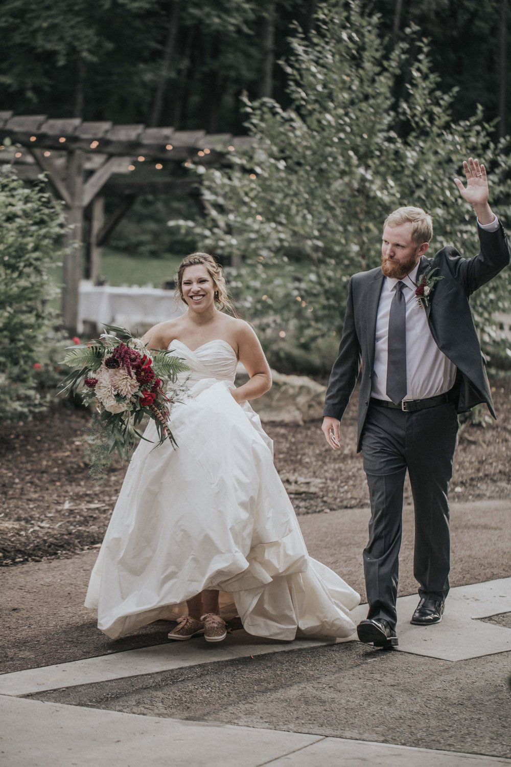 Bride and groom celebrate after wedding ceremony for rustic wedding in Farmington, PA planned by Exhale Events. Find more wedding inspiration at exhale-events.com!
