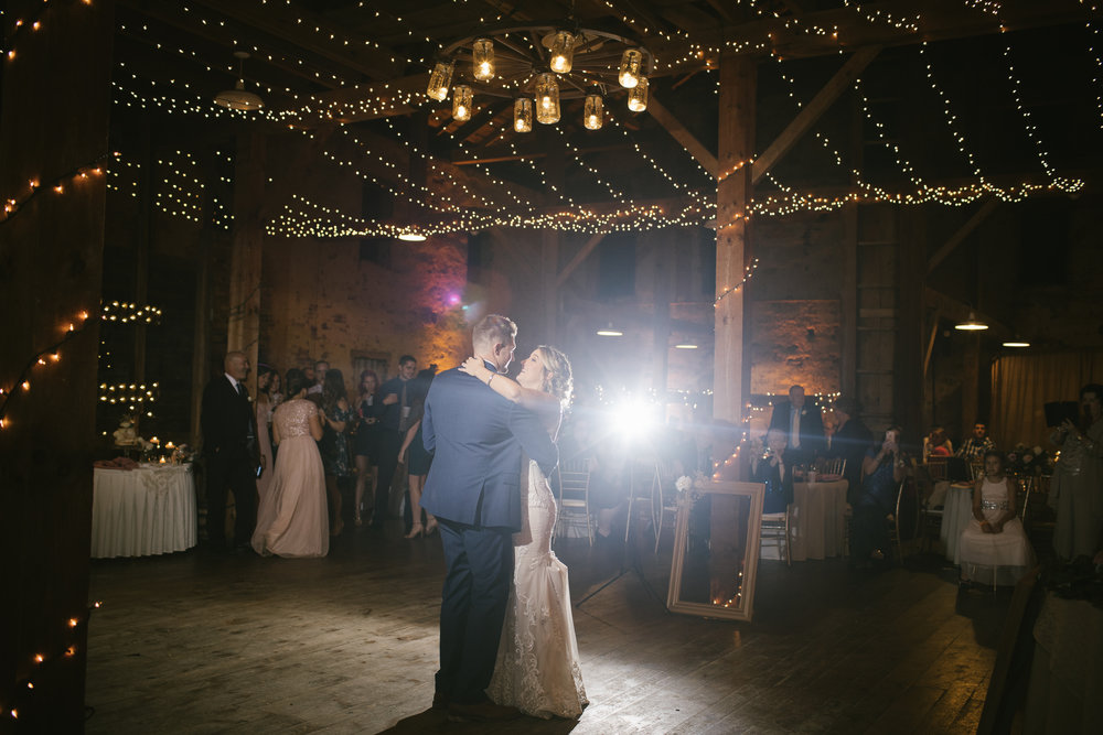 Bride and groom share first dance at rustic wedding in Pittsburgh, PA planned by Exhale Events. Find more wedding inspiration at exhale-events.com!