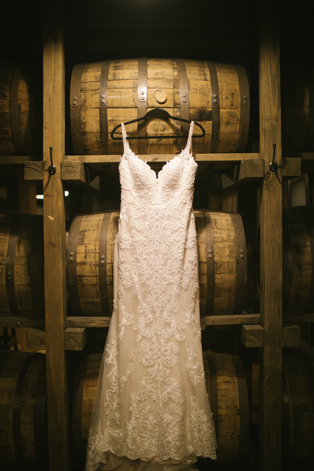 Bride's lace wedding dress for rustic wedding in Pittsburgh, PA planned by Exhale Events. Find more wedding inspiration at exhale-events.com!