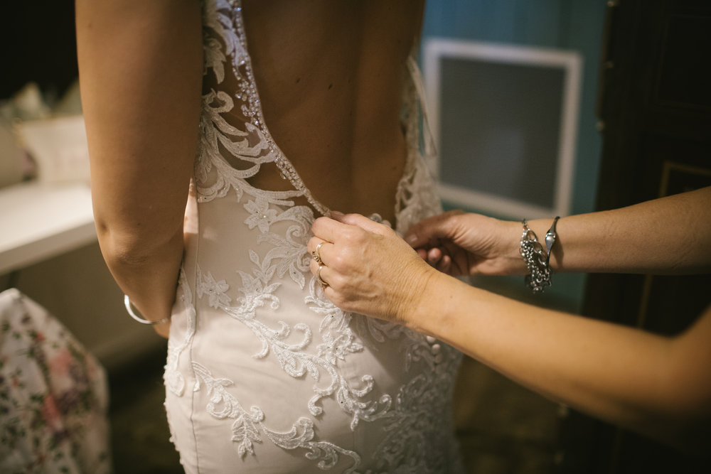Bride's embellished lace wedding dress for rustic wedding in Pittsburgh, PA planned by Exhale Events. Find more wedding inspiration at exhale-events.com!