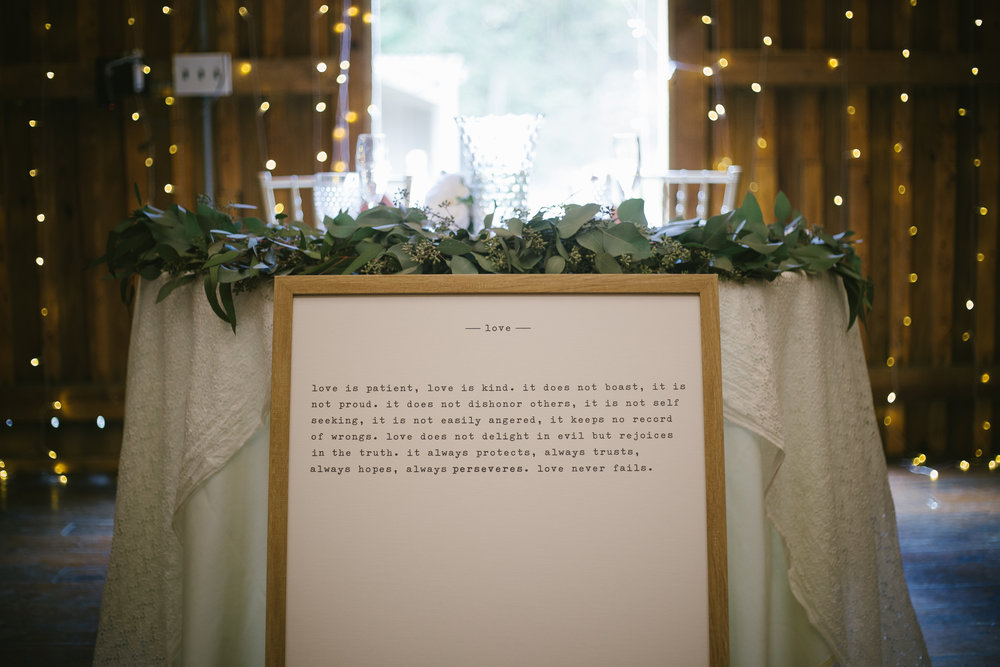 Wedding sign in front of wedding sweetheart table for wedding reception decor for rustic wedding in Pittsburgh, PA planned by Exhale Events. Find more wedding inspiration at exhale-events.com!