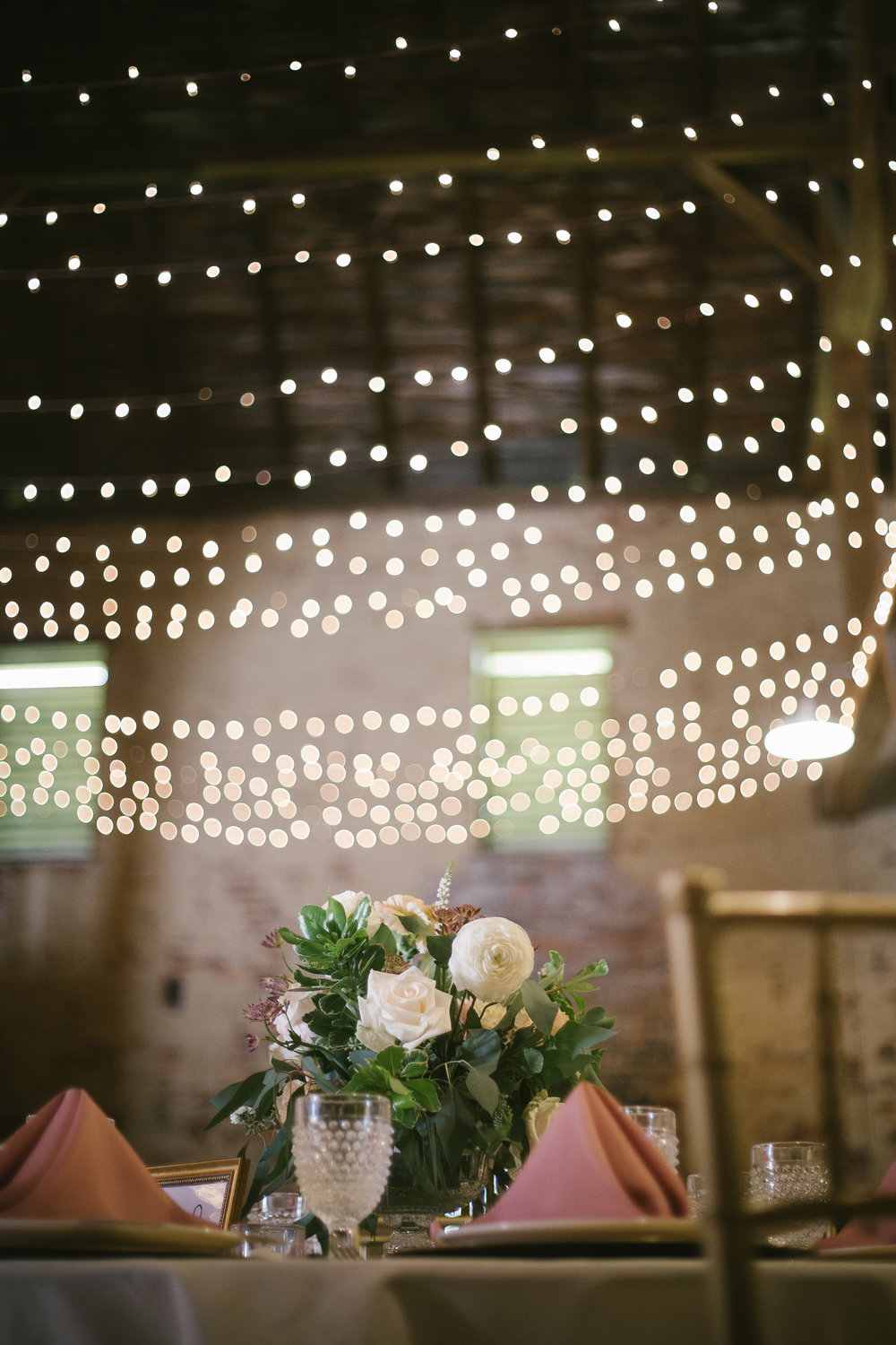 Wedding centerpiece and wedding lighting for rustic wedding reception decor in Pittsburgh, PA planned by Exhale Events. Find more wedding inspiration at exhale-events.com!