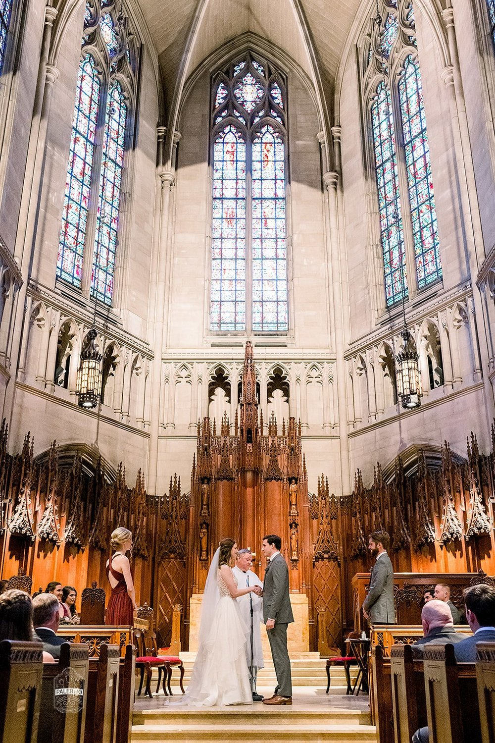 Bride and groom exchange vows during wedding ceremony at Heinz Chapel in Pittsburgh, PA planned by Exhale Events. Find more wedding inspiration at exhale-events.com!