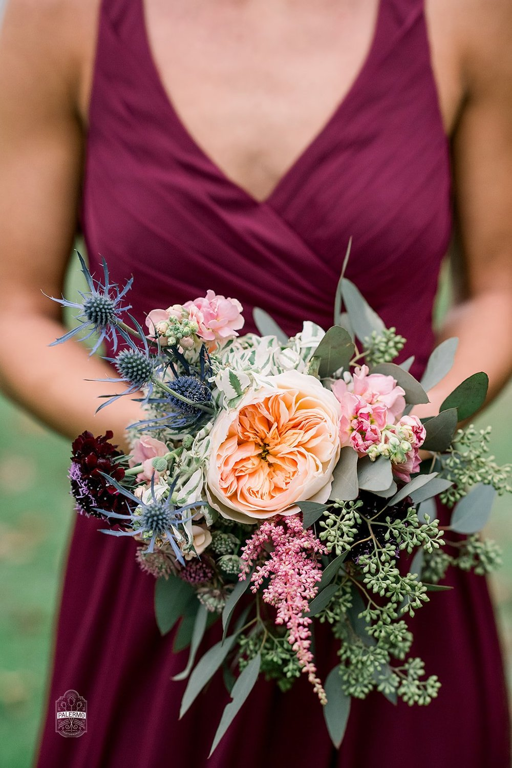 Sangria bridesmaids dresses with wedding bouquet for fall barn wedding in Pittsburgh, PA planned by Exhale Events. Find more wedding inspiration at exhale-events.com!